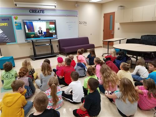 Students watch a Skype session and learn about Native Americans