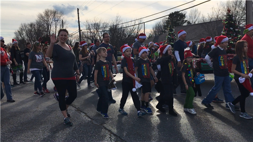 leadership team students walking in a Christmas parade