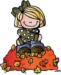 girl sitting on pile of leaves